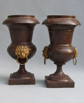 Pair of porphyry painted toleware Empire vases with gilded lion heads by Unknown Artist