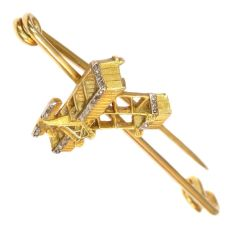 Unique gold diamond aviation brooch commemorating Belgium's first manned motorized flight by Unknown Artist