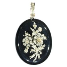 Antique Victorian onyx locket pendant with diamond loaded bouquet on top by Unknown