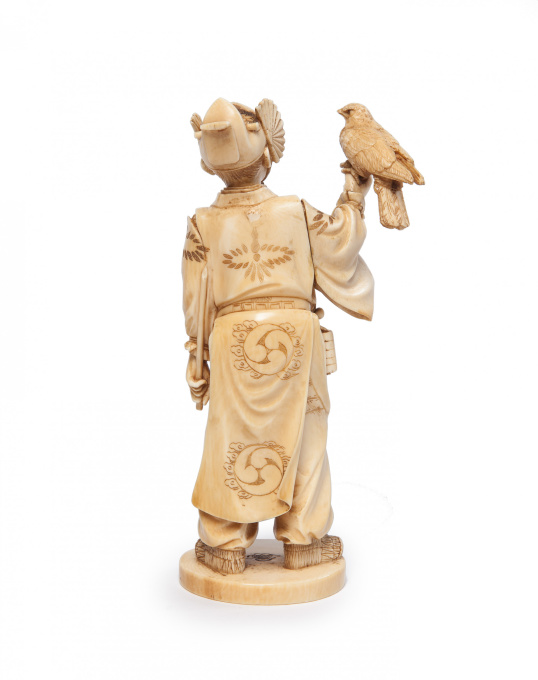 Japanese ivory statue of a falconer by Unknown Artist