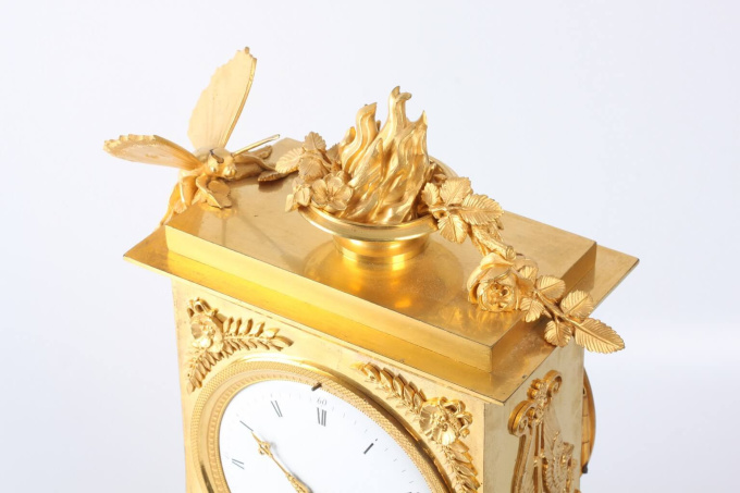 A French Empire ormolu mantel clock with butterfly, circa 1800 by Unknown Artist