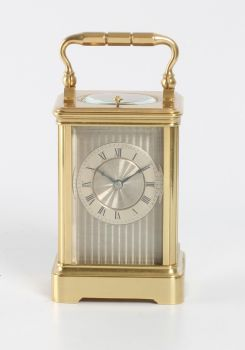 A small French brass striking carriage clock, circa 1860 by Unknown Artist