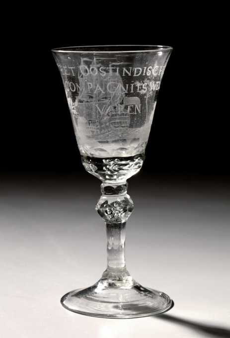 "A GLASS WITH THE ENGRAVING OF AN EAST-INDIAMAN AND WITH TEXT ""HET WEL VAAREN VAN DE OOSTINDISCHE COMPAGNIE"" by Unknown Artist"