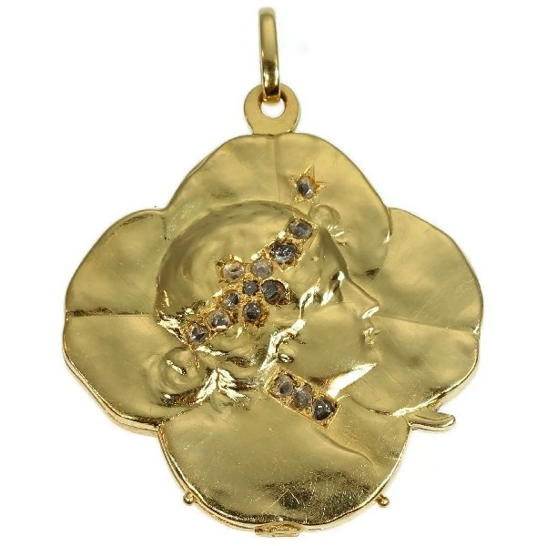 Art Nouveau gold pendant lucky clover with womans head set with rose cut diamond by Unknown Artist