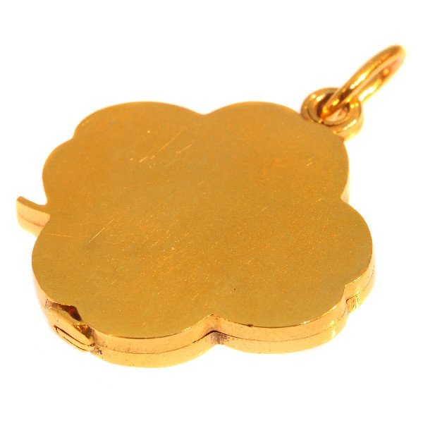 Art Nouveau gold slide locket four leaf clover with woman head by Unknown Artist