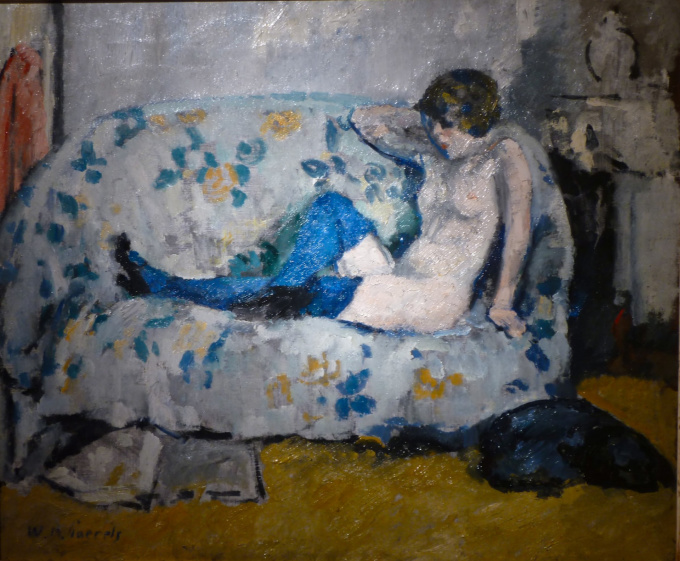 Sitting nude with blue stockings on sofa by Willem Paerels