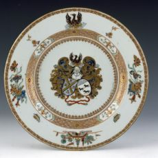 A pair of Chinese iron-red and gilt armorial plates