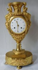 A fine and rare ormolu urn mantel clock, cupid and classical draped female figures holding flowers s