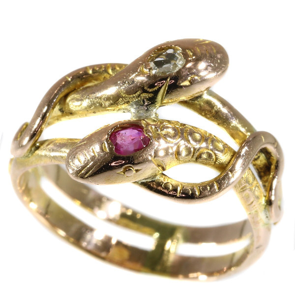 Antique gold double headed snake or serpent ring with ruby and diamond by Unknown Artist