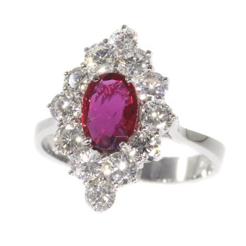 Vintage 1970's ring with beautiful ruby and set with 12 brilliant cut diamonds by Unknown Artist
