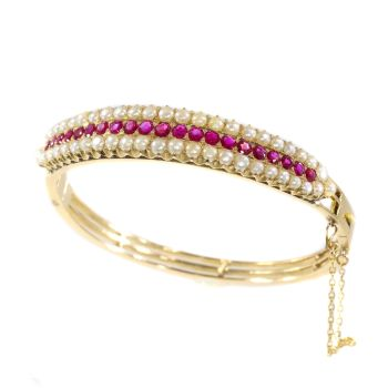 Vintage antique gold bangle with natural rubies and pearls sold by Simons Jewellers The Hague & Amsterdam by Unknown Artist