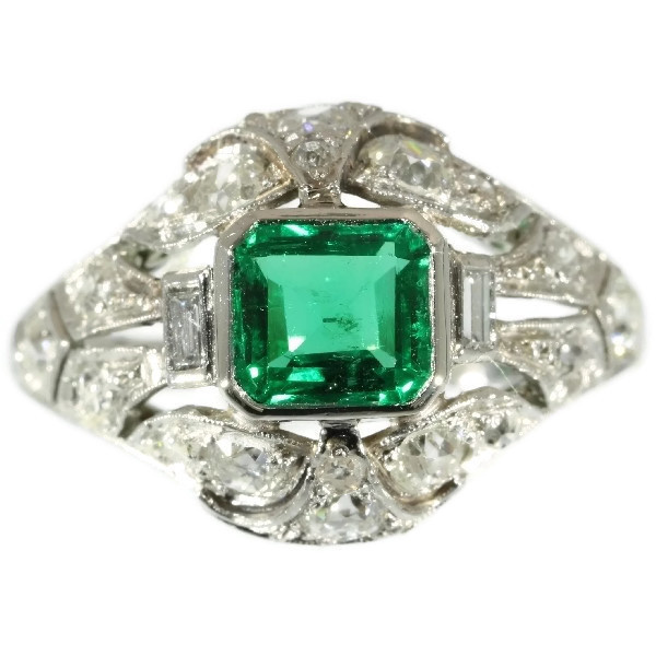 Platinum estate diamond engagement ring with truly magnificent Colombian emerald by Unknown