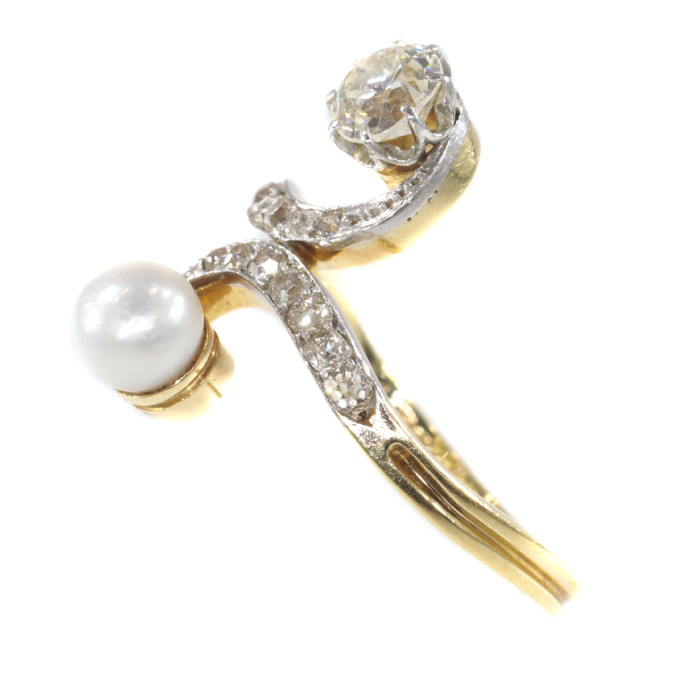 Elegant Belle Epoque diamond and pearl engagement ring so called toi et moi by Unknown Artist