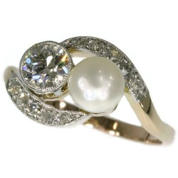 Romantic engagement ring with diamonds and pearl by Unknown Artist