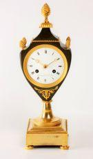 A fine French Empire ormolu and bronze urn mantel clock, circa 1800 by Armingaud Láîné à Paris