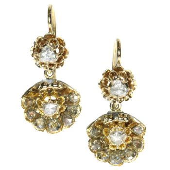 Antique Victorian earrings a shell motif set with rose cut diamonds by Unknown Artist