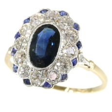 Most elegant diamond and sapphire Lady Di type of engagement ring by Unknown Artist