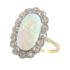 Vintage opal and diamond engagement ring by Unknown
