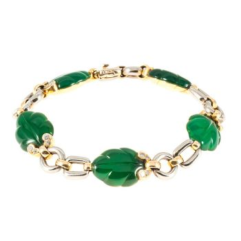 Cartier leaf bracelet with green chalcedony by Cartier .