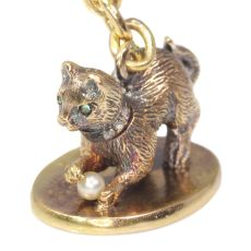 Antique gold kitten with diamond collar playing with little pearl on seal by Unknown Artist