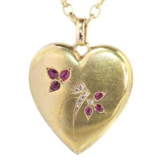 Victorian gold heart shaped locket set with diamonds and rubies by Unknown