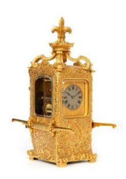 A French gilt brass 'sedan chair' carriage clock, circa 1870 by Unknown Artist