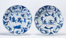 A pair of blue and white equestrian dishes