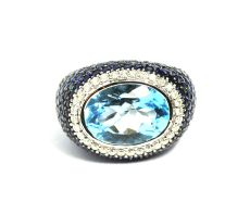 Blue topaz with blue sapphire and brilliant cut diamonds ring
