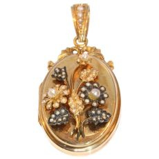 Victorian rose gold locket with seed pearl set bouquet of flowers on top by Unknown