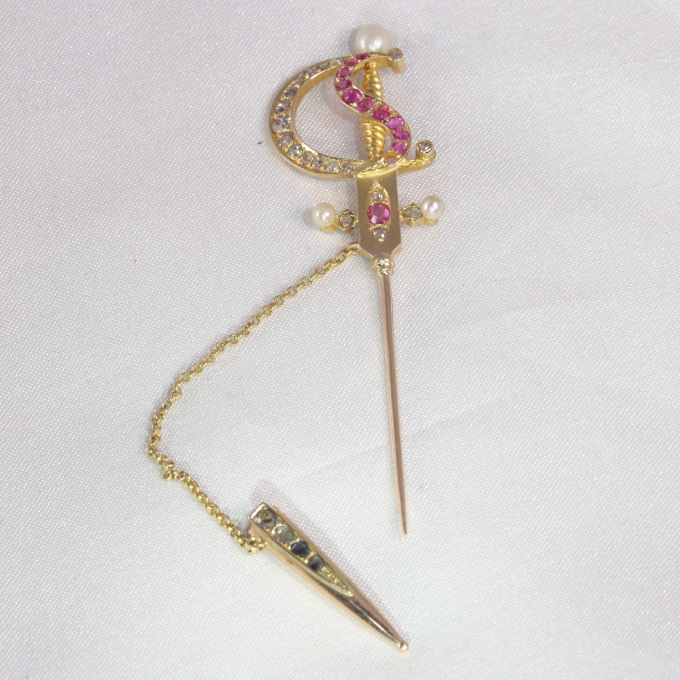 Antique gold pin in the shape of a bejeweld sword by Unknown Artist