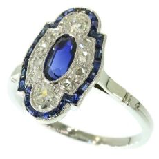 Elegant estate platinum Art Deco diamond and sapphire engagement ring by Unknown Artist