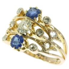 Antique Victorian ring multi shank with diamonds and sapphires by Unknown Artist