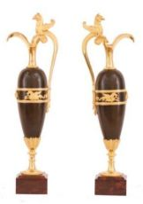 A pair of empire patinated bronze and fire gilded ewers, Circa 1810 by Unknown Artist