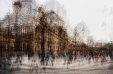 The Louvre surrounded by people by Jack Marijnissen