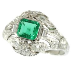 Platinum estate diamond engagement ring with truly magnificent Colombian emerald by Unknown Artist