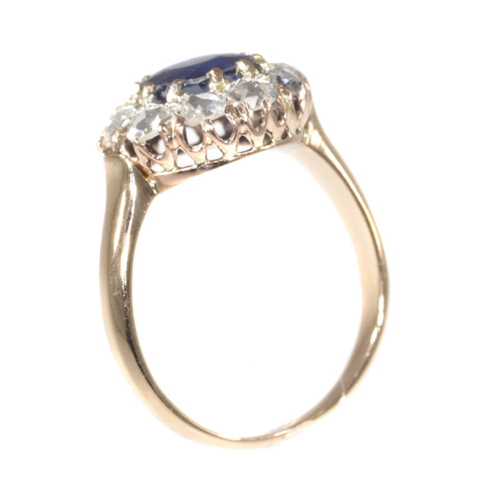 Victorian antique engagement ring with natural sapphire and ten rose cut diamonds by Unknown
