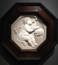 An octagonal Vanitas relief by Unknown Artist