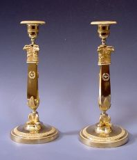 A pair exclusive Empire candlesticks, eagle-heads,