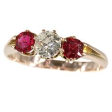 Antique ring with old mine brilliant cut diamond and two red strass stones by Unknown