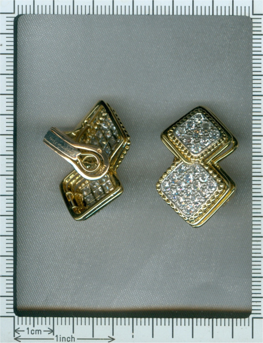 Signed Boucheron Paris estate diamond earclips gold and platinum by Boucheron .
