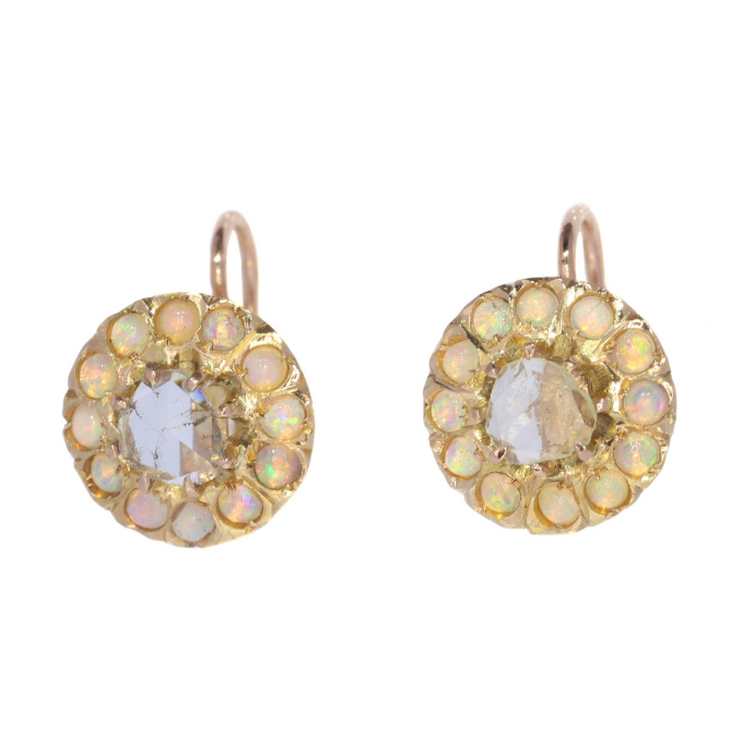Victorian gold earstuds set with large rose cut diamonds and 24 opals by Unknown Artist