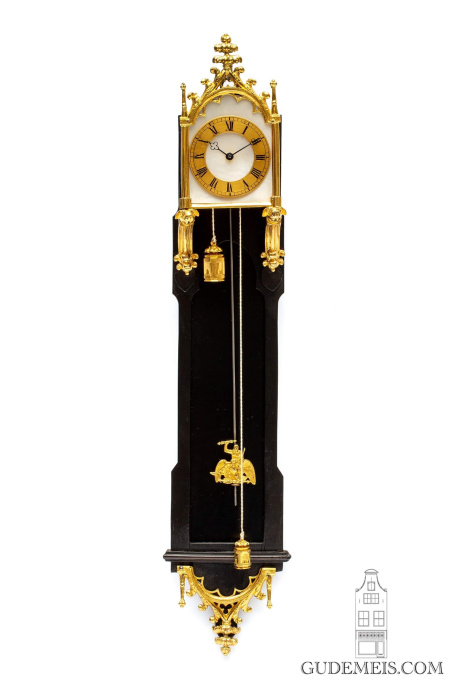 A miniature Austrian Neo Gothic gilt brass mounted ebony 'brettl' wall timepiece, circa 1840 by Unknown Artist