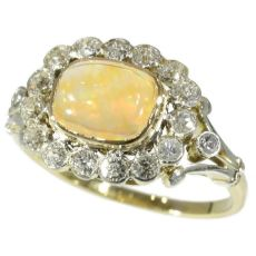 Belle Epoque vintage engagement ring with fire opal and old mine cut diamonds by Unknown Artist