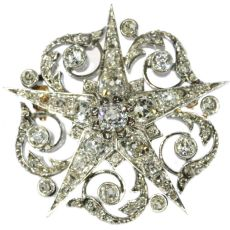 French Victorian antique star brooch filled with old mine brilliant cut diamonds by Unknown Artist