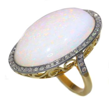 Vintage gold ring with humongous 30+ carat high quality opal and 56 rose cut diamonds by Unknown Artist