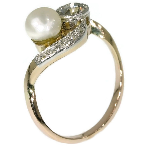 Romantic engagement ring with diamonds and pearl by Unknown