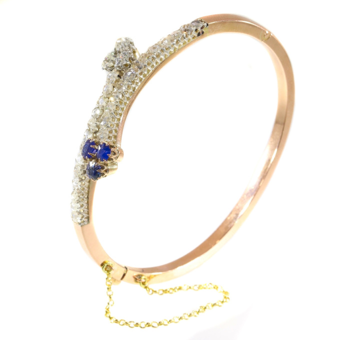 Victorian diamond and sapphire cross over bangle by Unknown Artist