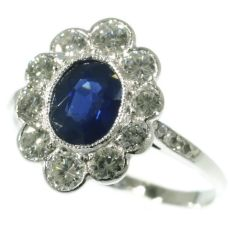 Vintage platinum Lady Di engagement ring with brilliant and sapphire by Unknown Artist