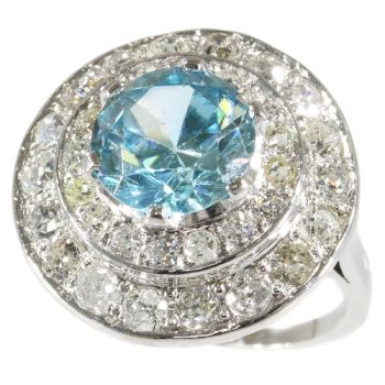 Diamond loaded radiant circular with a big starlite in its center by Unknown Artist
