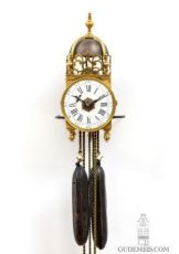 A rare miniature French brass striking and alarm lantern clock, circa 1750 by Unknown Artist